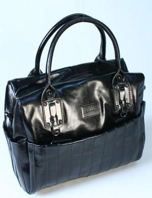 Дата: 26.12.2011 Добавил: admin_admin.  Женская сумка Palio выполнена из кожи черного цвета.