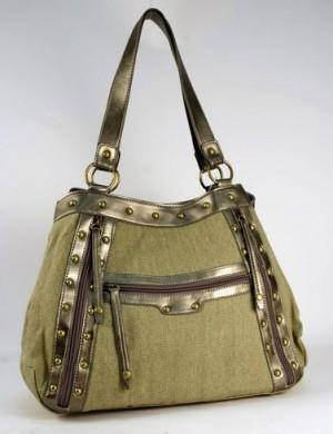 Женская сумка выполнена из ткани темно-серого цвета, отделка...