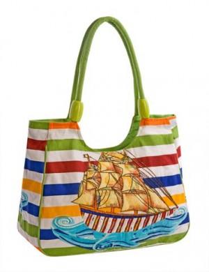 Яркая пляжная сумка Collage выполнена из текстиля разнообразных ярких...