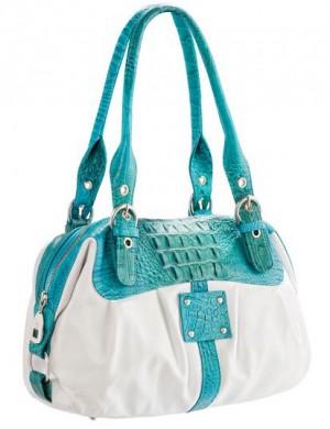Женская сумка Eleganzza, выполненная из натуральной кожи белого цвета...